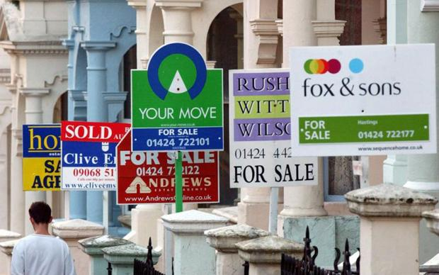 House prices report...Embargoed to 0001 Monday October 15  File photo dated 22/08/02 showing estate agents signs outside properties in Hastings, Kent. House prices rebounded by a strong 2.7% during September, more than wiping out the previous month's fall, figures showed today. PRESS ASSOCIATION Photo. Issue date: Monday October 15 2007. Property website Rightmove said the gain during the four weeks to October 6 was the strongest for six months and helped push the average price of a home in England and Wales up to  241,642. See PA MONEY House. Photo credit should read: Toby Melville/PA Wire